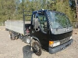 Photo 2004 Isuzu NPR 300 turbo table top tailgate...